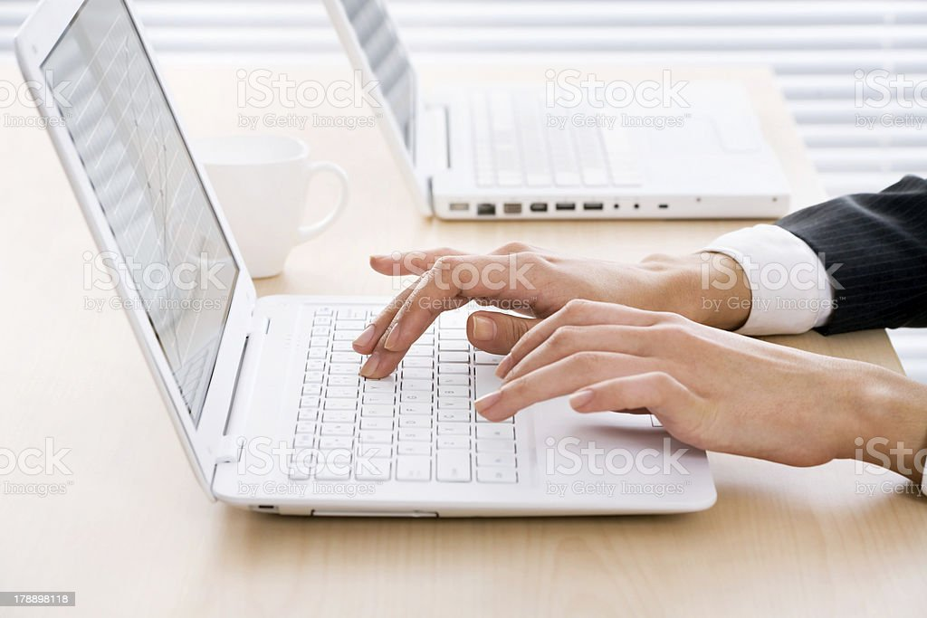 Female hands on laptop royalty-free stock photo