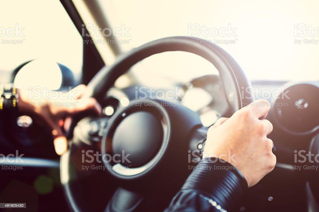 Female hands on steering wheel stock photo