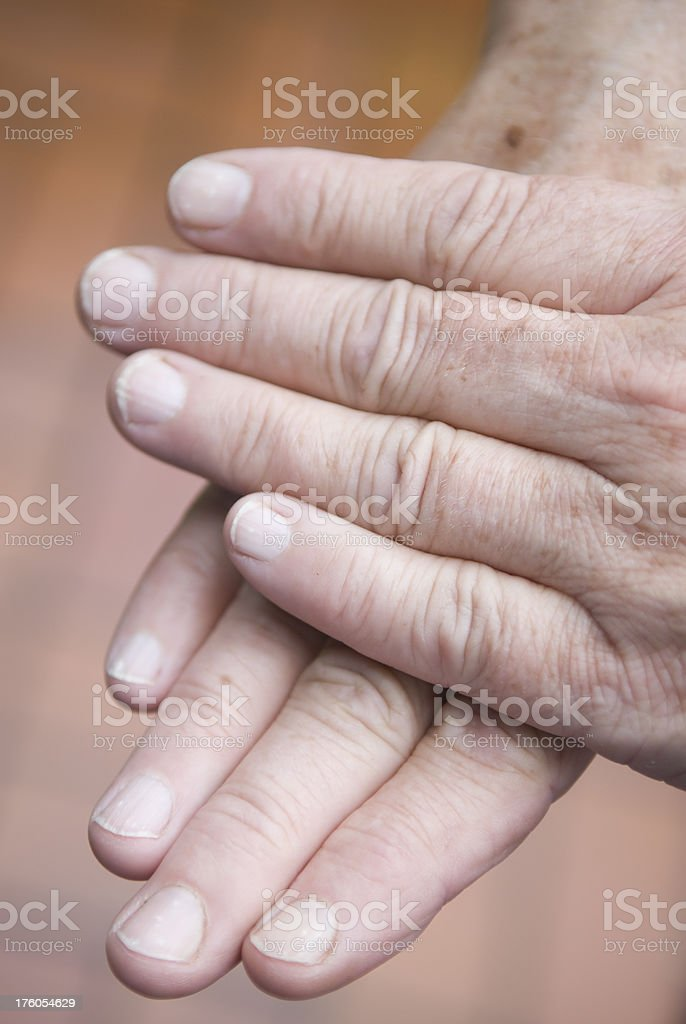 Female hands on top of each other, caucasian, selective focus royalty-free stock photo