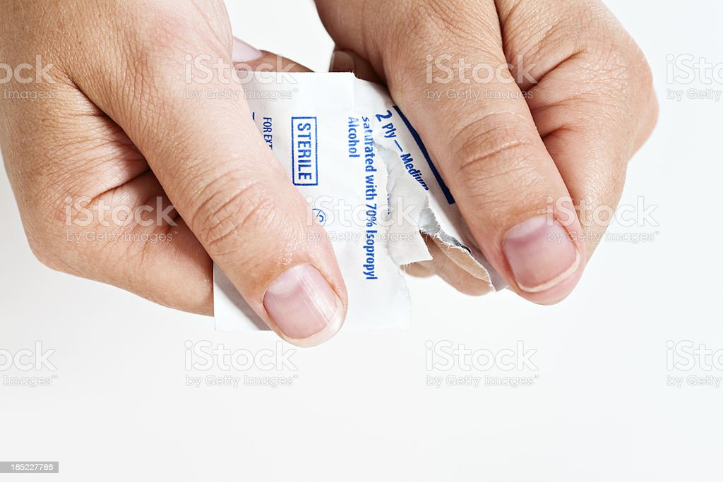 Female hands open sterile swab used to disinfect skin stock photo
