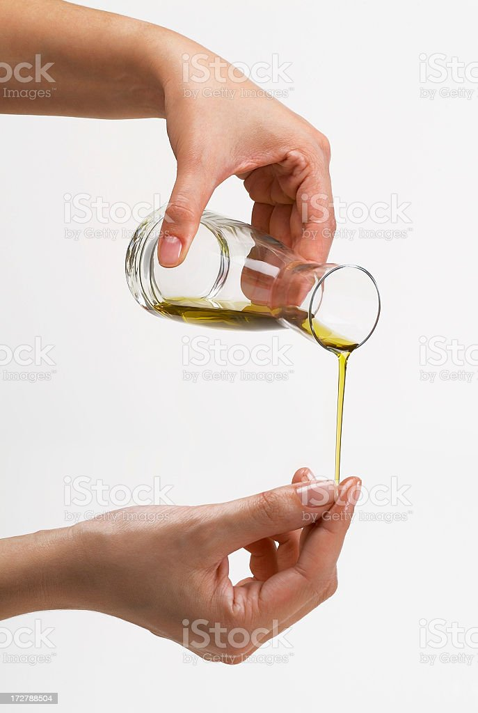 A female hands pouring some oils from a bottle stock photo