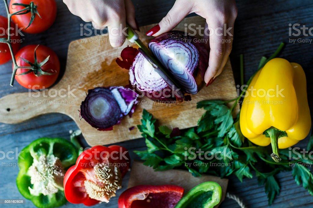 Female hands preparing a salad of fresh vegetables stock photo