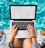 Female Hands Typing Macbook Poolside Concept