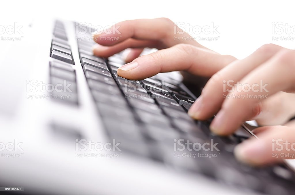 Female hands typing on keyboard royalty-free stock photo