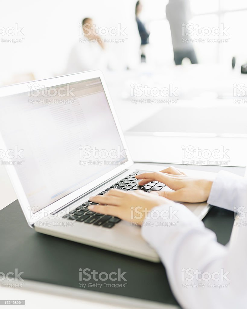 Female Hands Typing on Notebook PC Modern Office Environment royalty-free stock photo