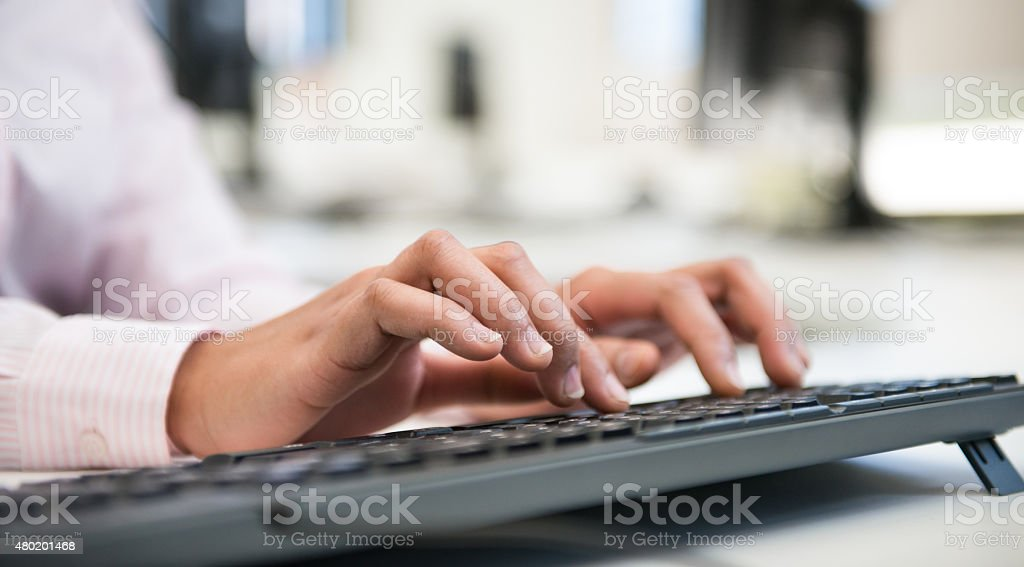 Female Hands Typing stock photo
