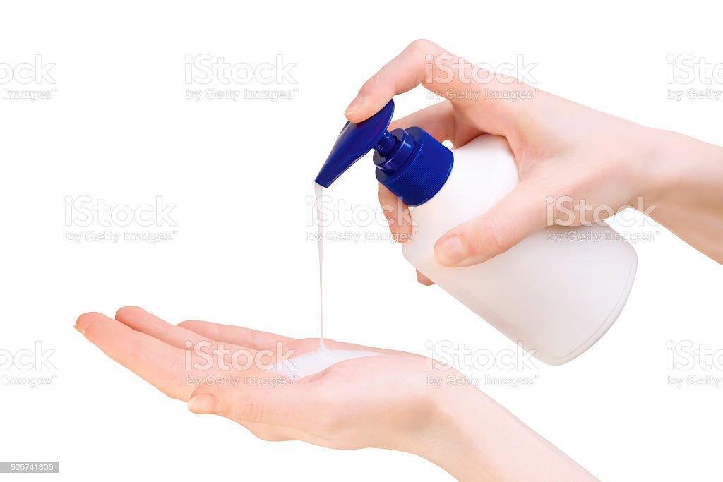 Female hands using liquid soap stock photo
