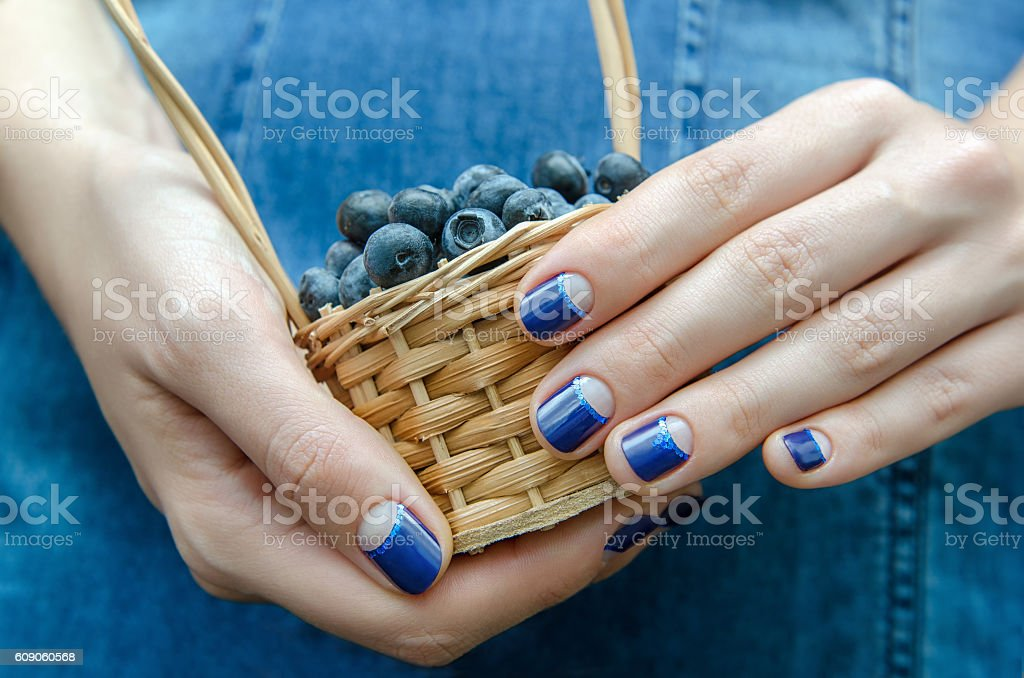 Female hands with blue nail design. stock photo