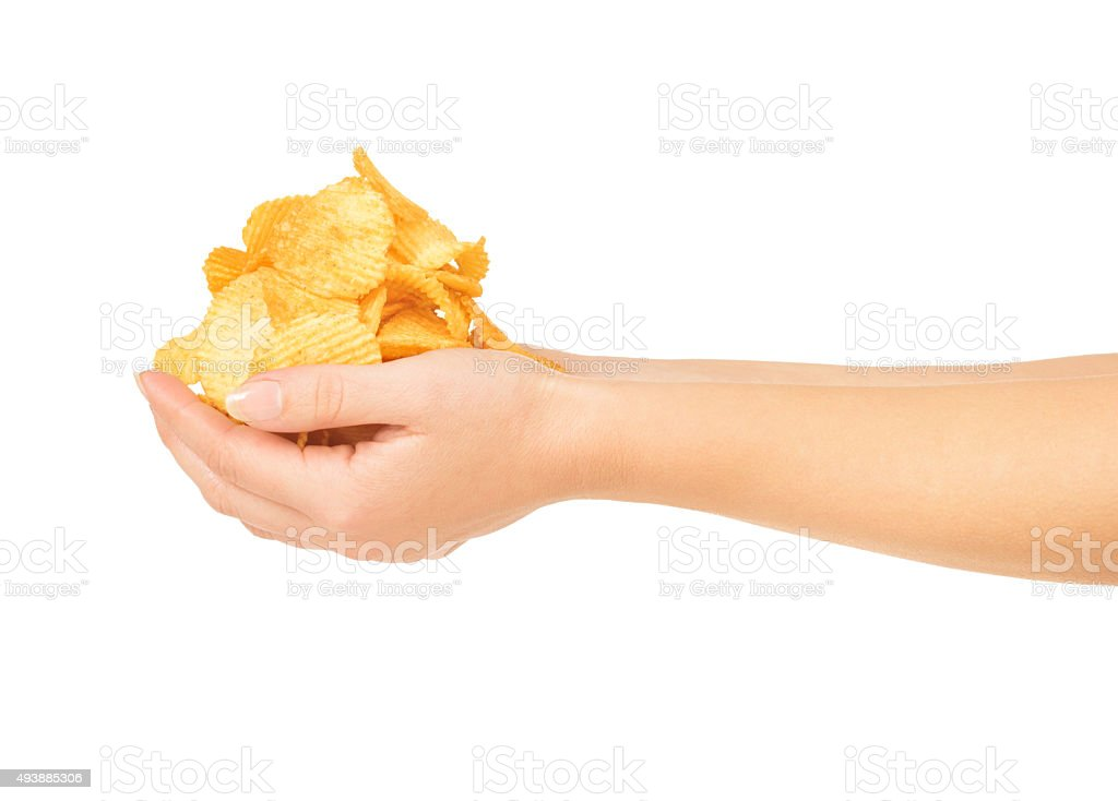 Female hands with chips isolated on white stock photo