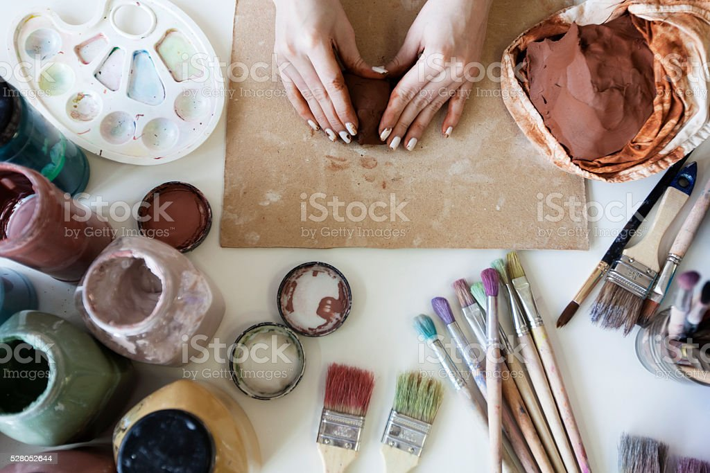 Female hands with clay stock photo