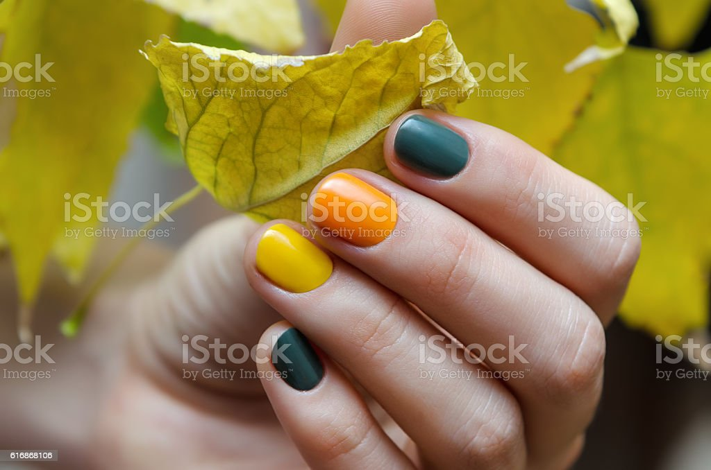 Female hands with color nail design. stock photo