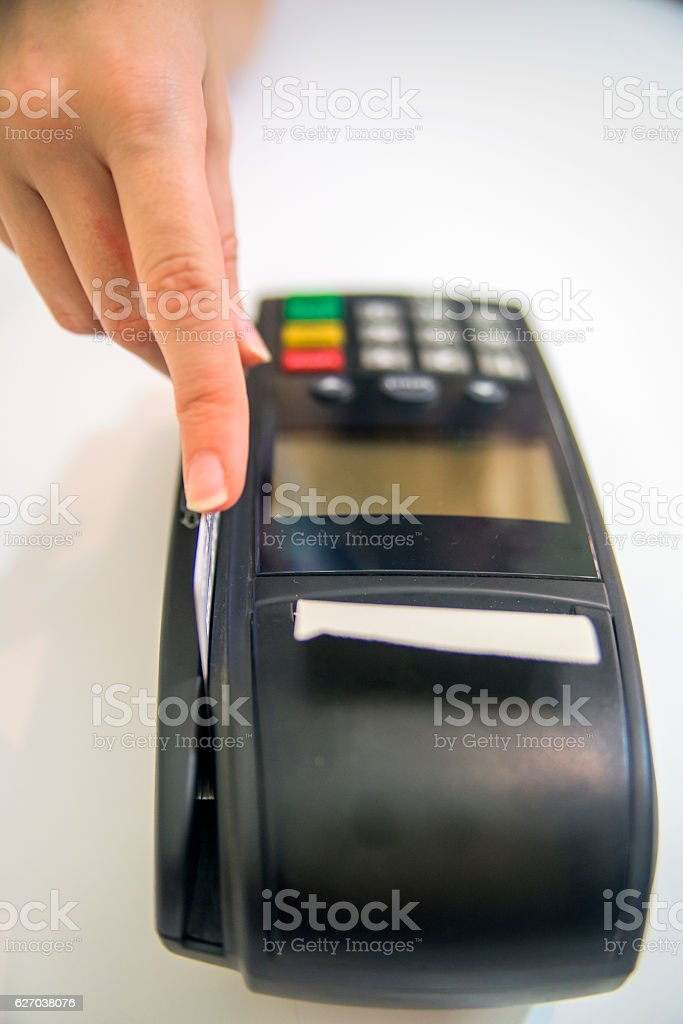 female hands with credit card and bank terminal. stock photo