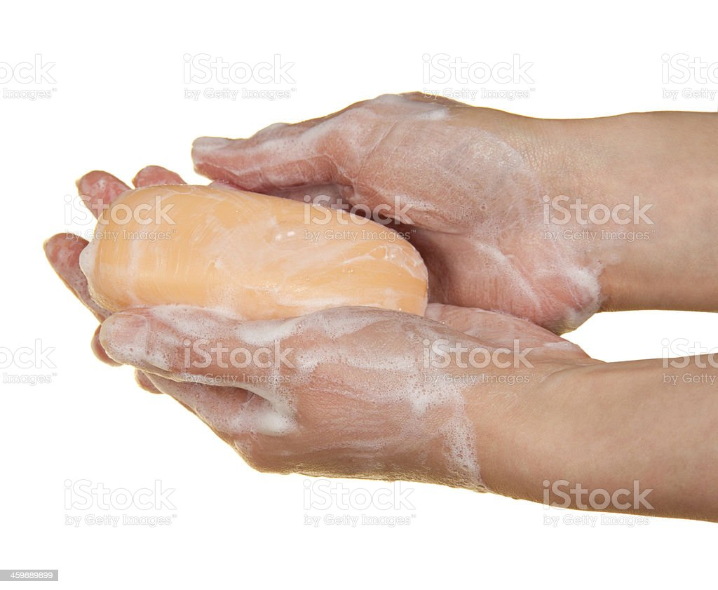 Female hands with the soap stock photo
