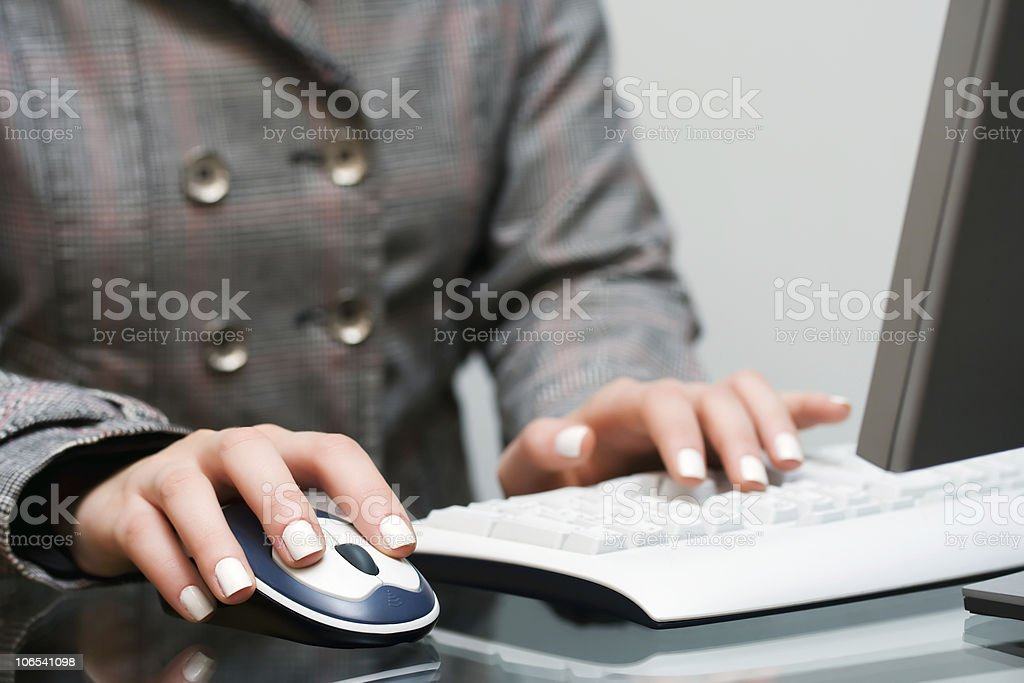 Female hands working on the computer royalty-free stock photo