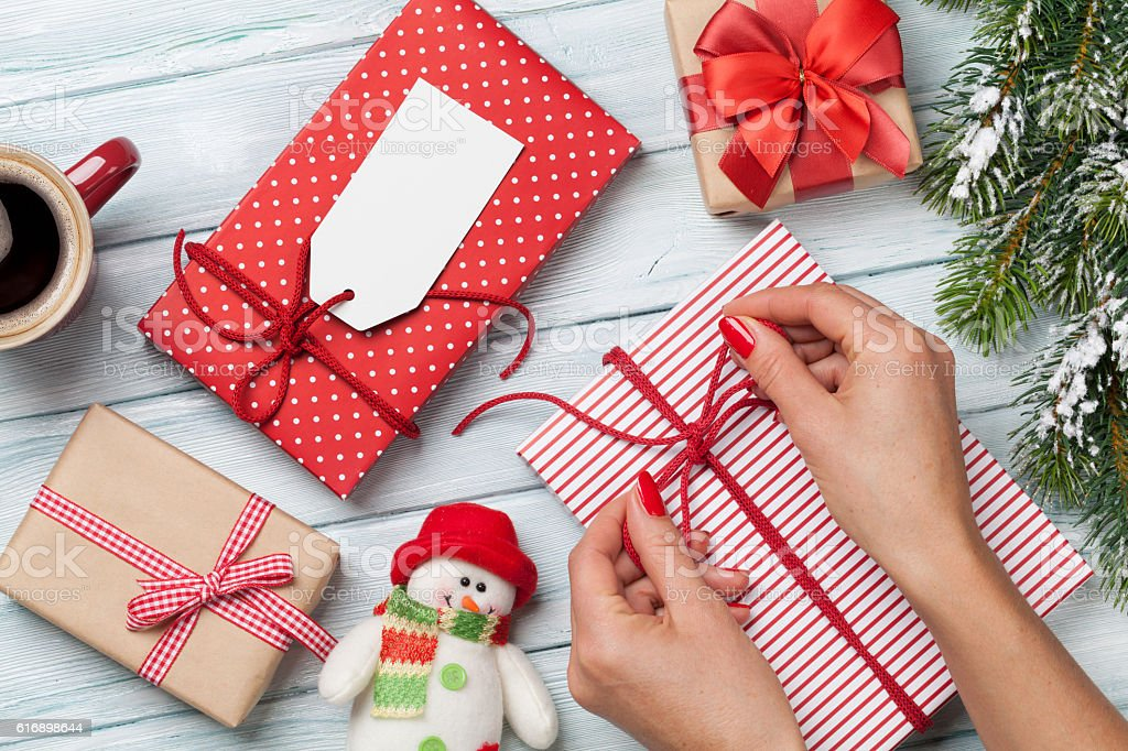 Female hands wrapping xmas gift stock photo