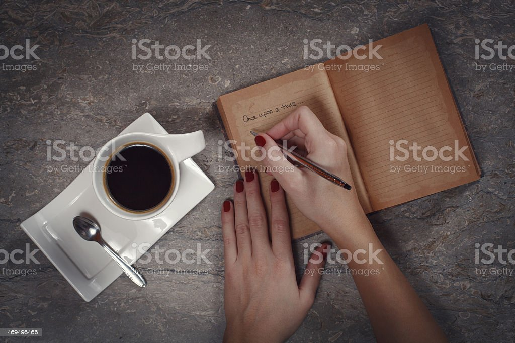 Female hands writing in diary stock photo