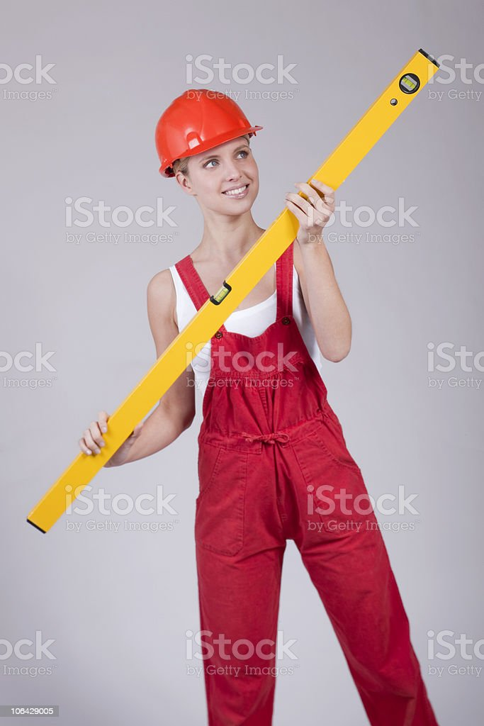 Female handworker with level royalty-free stock photo