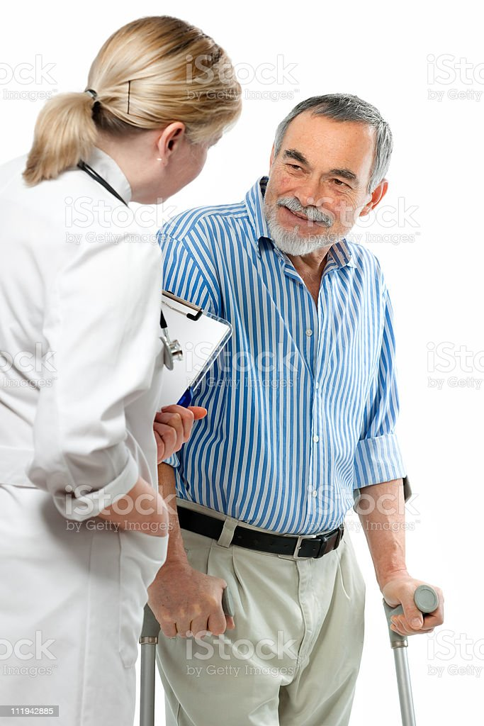 Female health care worker talking with a male patient royalty-free stock photo