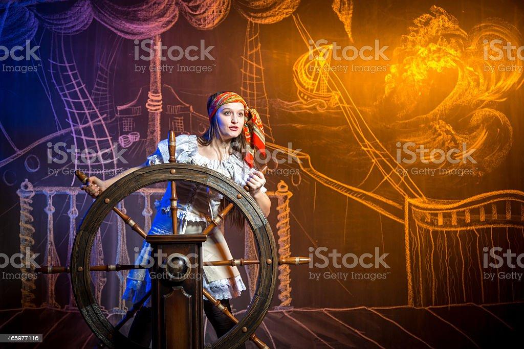 Female Helmsman of Pirate Ship stock photo
