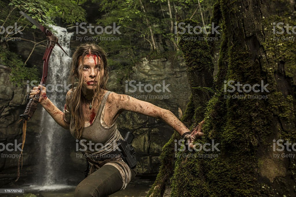 Female Heroine in the Jungle Hunting with Pick Axe royalty-free stock photo