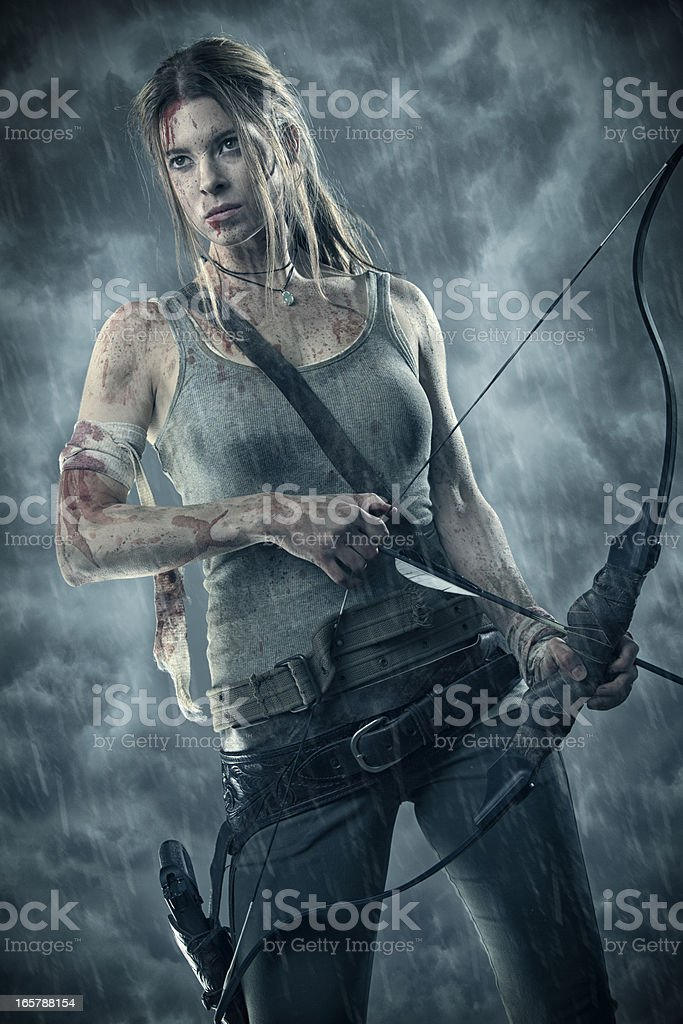 Female heroine with bow and arrow royalty-free stock photo