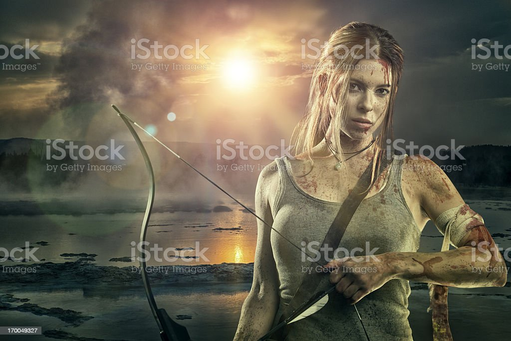 Female heroine with bow and arrow stock photo