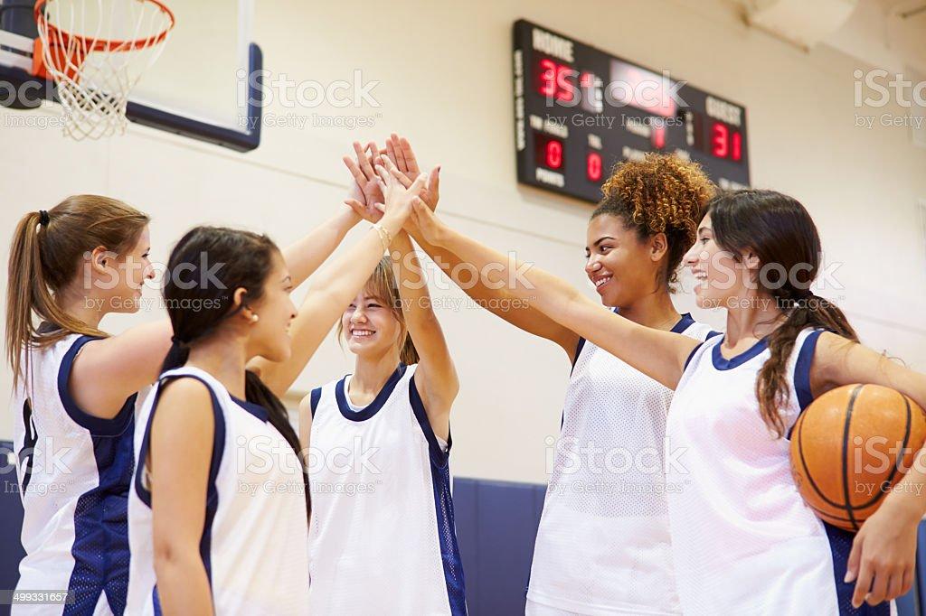 Female High School Basketball Team Having Team Talk Putting Hands In