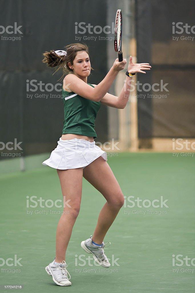 Female High School Tennis Player Follows Through on Forehand Stroke royalty-free stock photo