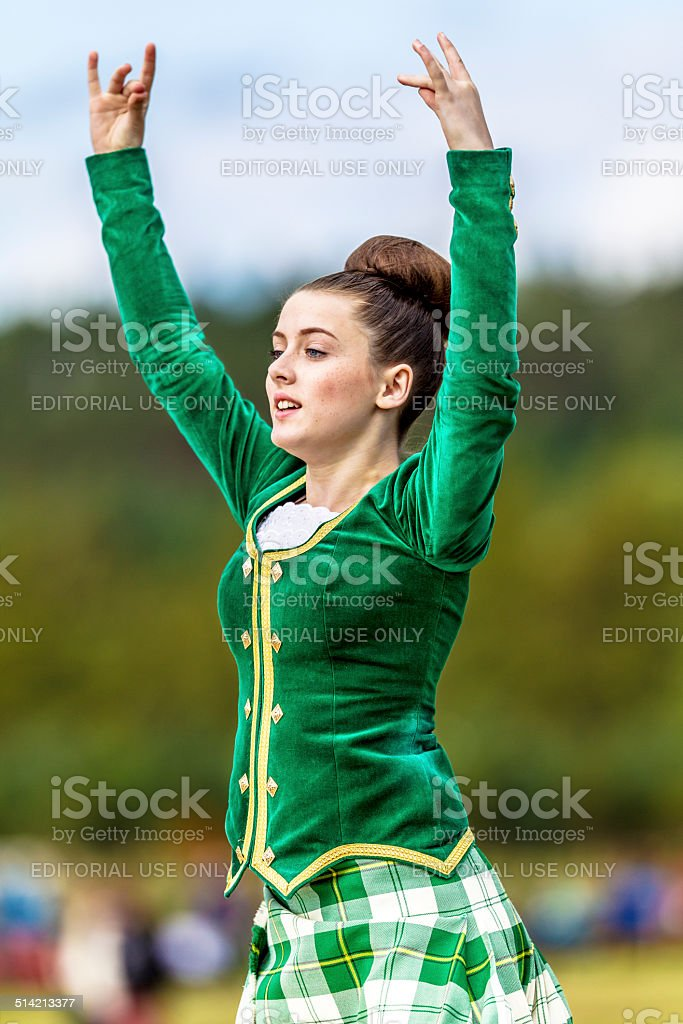 Female highland Scottish dancer in competition stock photo