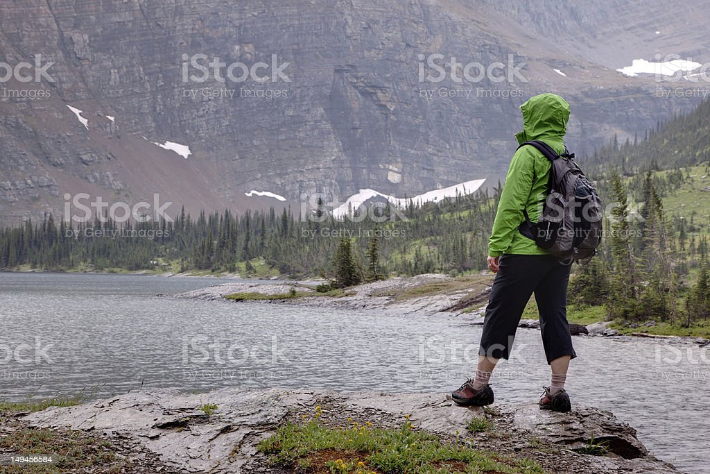 Female Hiker in Rainy Weather Admiring the View royalty-free stock photo