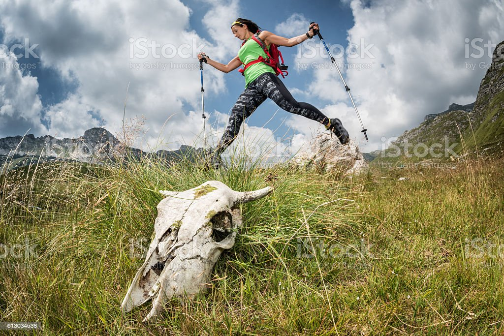 Female hiker in the jump stock photo
