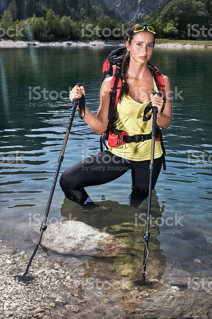 Female hiker in the lake stock photo