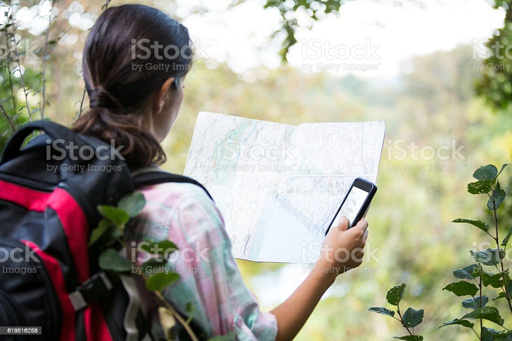 Female hiker looking at map stock photo