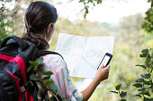 Female hiker looking at map