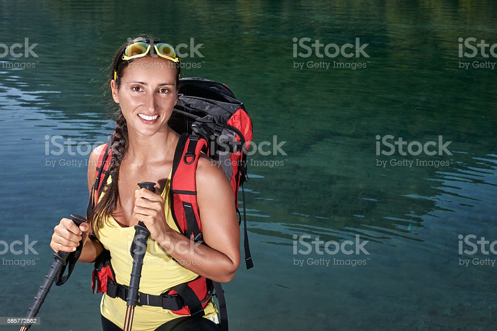 Female hiker near the lake stock photo