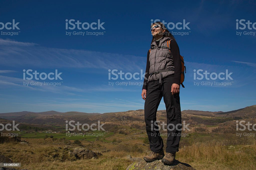 Female hiker on rock stock photo