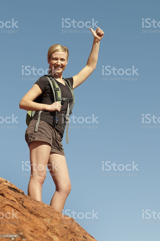 Female Hiker on Top of a Hill royalty-free stock photo