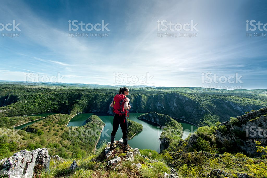 Female hiker on top of a hill stock photo