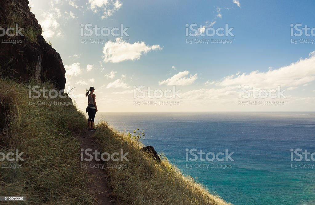 Female hiker overlooking beautiful coast stock photo