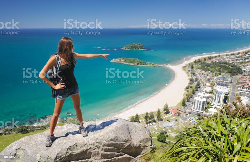 Female Hiker overlooking Mt. Maunganui, Bay of Plenty, New Zealand royalty-free stock photo