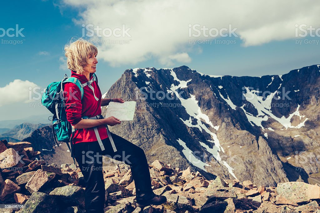 Female hiker reading map on Ben Nevis, Scotland stock photo