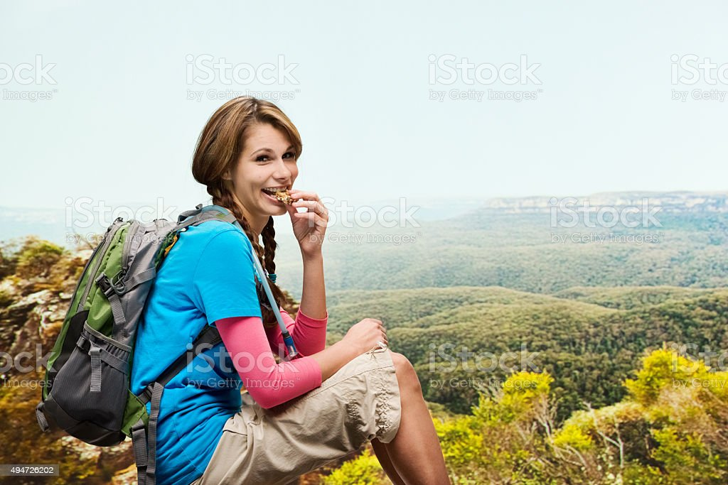Female hiker sitting on mountains stock photo