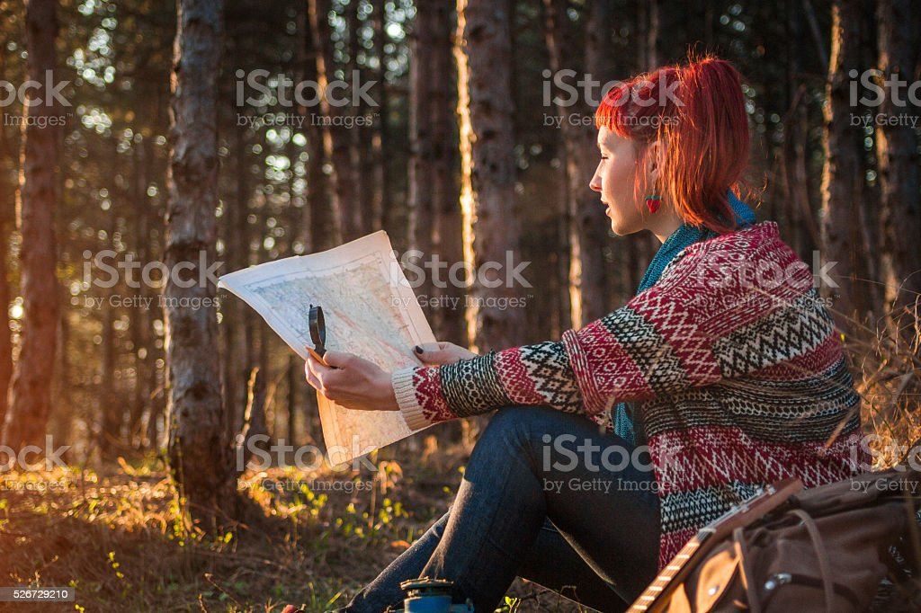 Female hiker taking a rest from walking stock photo