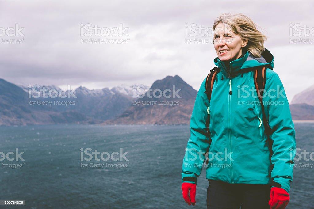 Female hiker walking on coastal trail in Skye stock photo