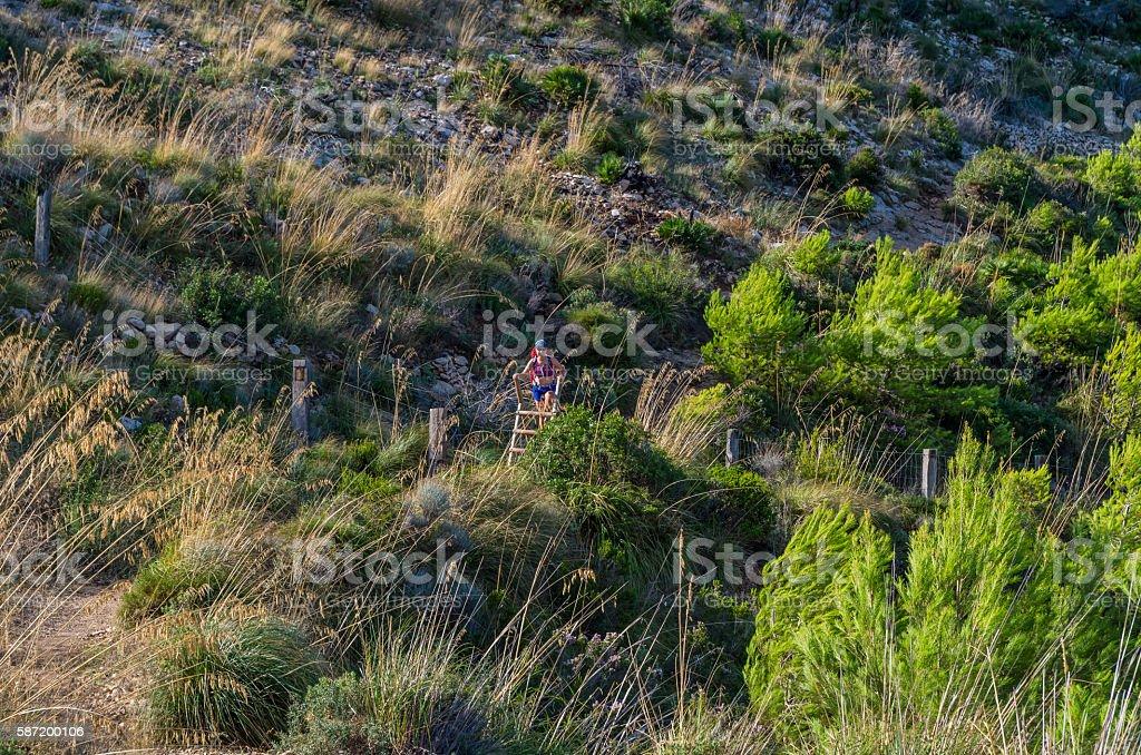 Female hiking in the mountains of Tramuntana, Mallorca, Baleares, Spain stock photo