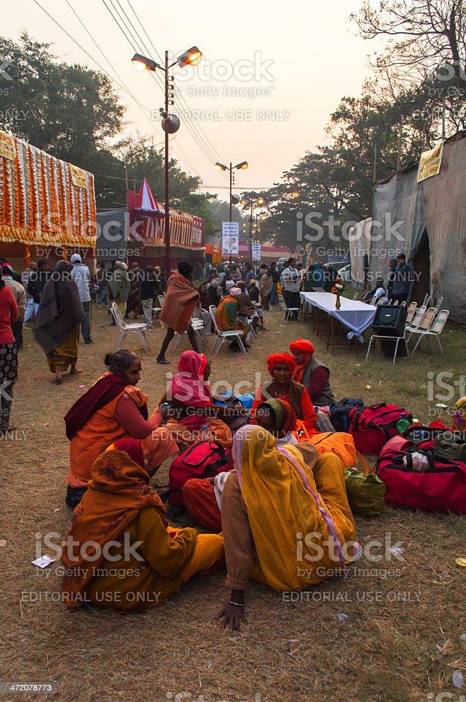 Female Hindu devotees gossiping stock photo