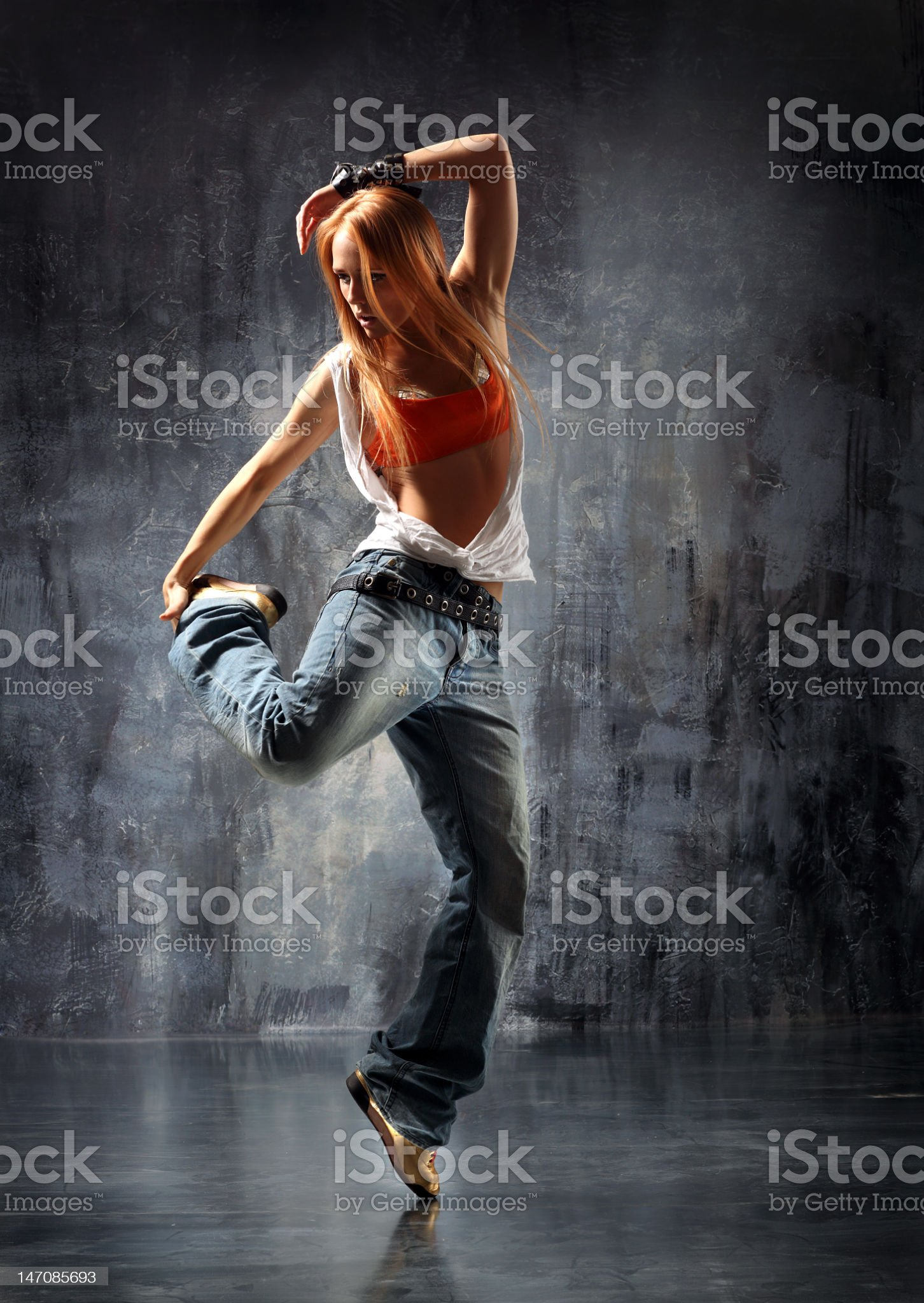 A female hip-hop dancer and a black background royalty-free stock photo