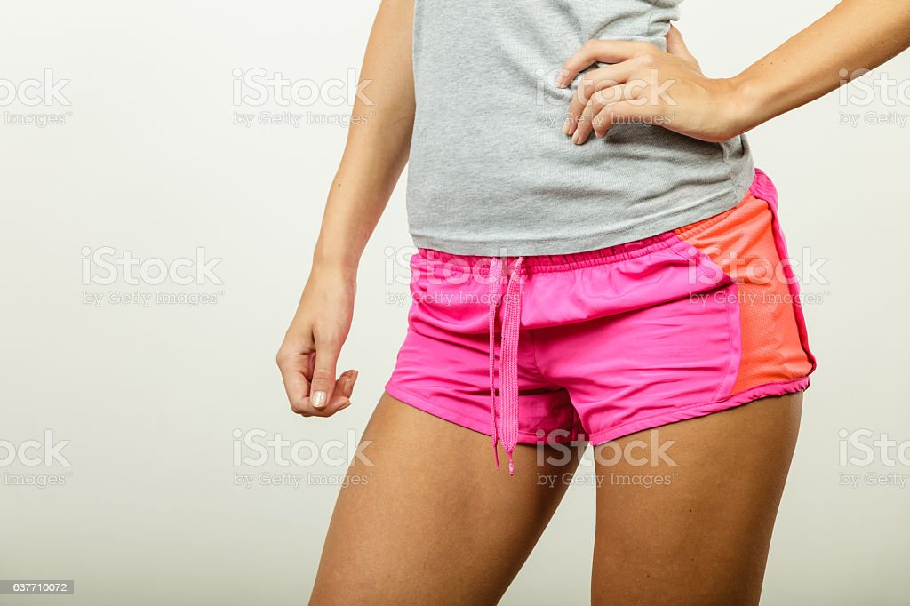 Female hips in sporty shorts stock photo