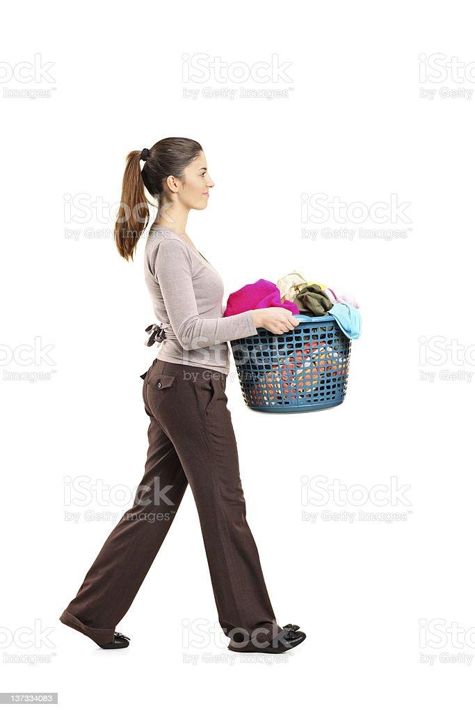 Female holding a laundry basket royalty-free stock photo