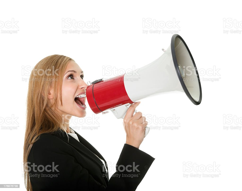 A female holding a megaphone to her mouth and yelling royalty-free stock photo